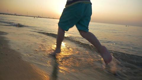 Feet of Boy Running on the Beach Footage