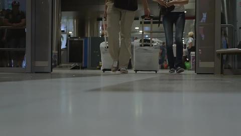 People Walking through Sliding Doors in Airport or Railway Station Footage