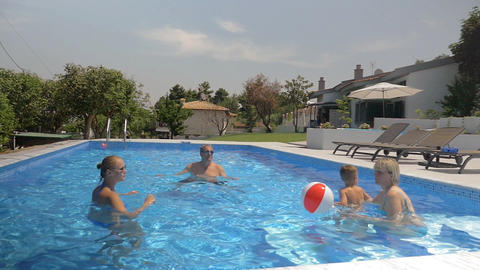 Family playing with a ball in the pool Footage