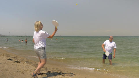 People Playing Beach Tennis by the Seaside Footage