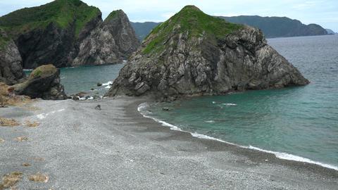 Amami Oshima, Japan - June 18, 2019: Honohoshi beach in Amami Oshima famous for rattles of stones on Footage