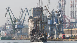 Galleon ship on a tour to Westerplatte. Gdansk shipyard in the background Footage
