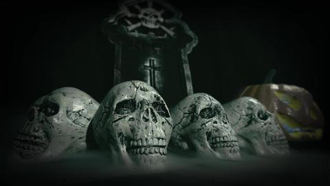 Old film look of halloween set decoration with skulls, grave and jack o'lantern - still shot Footage