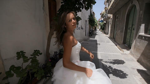 Gentle, charming, sweet bride in a chic dress on the narrow streets of the old ビデオ
