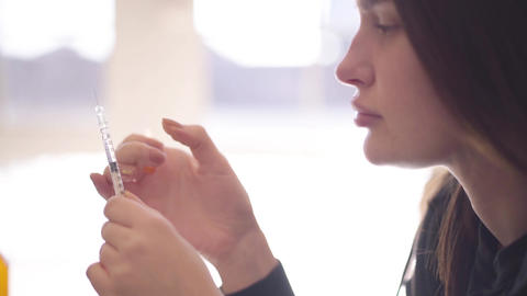 Addict woman with a syringe close-up. Drug addiction.…, Live Action