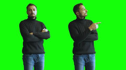 Joyful unshaven man making fun gestures at green screen background Footage