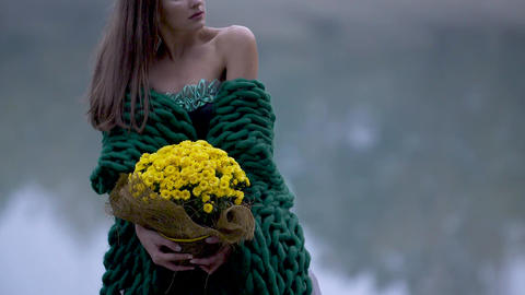 a portrait of young gorgeous lady with a bouquet Live Action