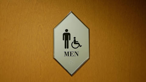 Motion of disable and man washroom logo on wall with 4k resolution Footage