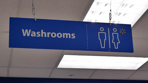 Motion of man and woman washroom logo on wall with 4k resolution Footage