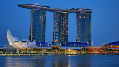 Scenic Marina Bay Sands hotel illuminated in the evening in Singapore Footage