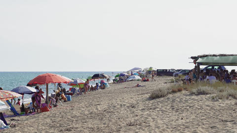 Greek Mediterranean unorganized beach with crowd in... Stock Video Footage