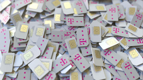 Pile of SIM cards with Deutsche Telekom AG logo, close-up. Editorial ビデオ