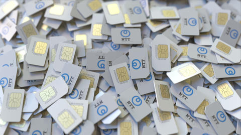 SIM cards with Nippon Telegraph and Telephone Corporation NTT logo, close-up ビデオ
