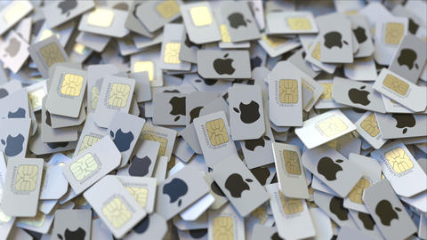 Pile of SIM cards with Apple Inc logo, close-up. Editorial telecommunication ビデオ