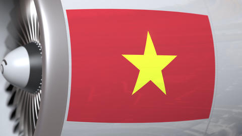 Turbine with flag of Vietnam. Vietnamese air transportation related conceptual Live Action