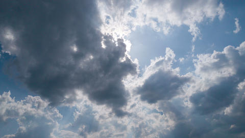 Sky with sun and clouds timelapse GIF