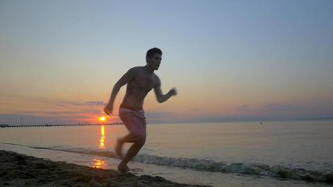 Acrobat Making Somersault on the Beach Footage