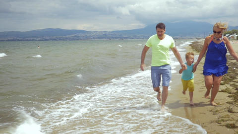 Happy family running on the seaside Footage