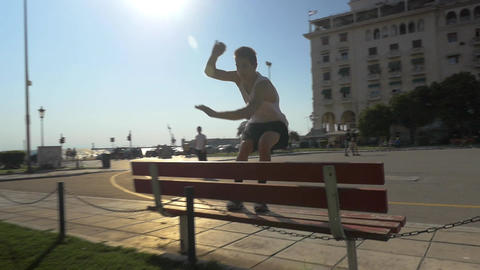 Parkour in the City. Tracer Jumping over the Bench Footage