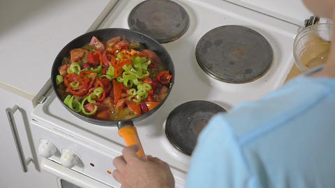 Man Adding Fresh Pepper into the Frying Pan Footage