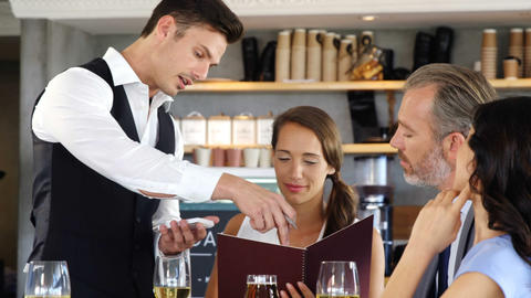 Waiter taking the order from a businessman Footage