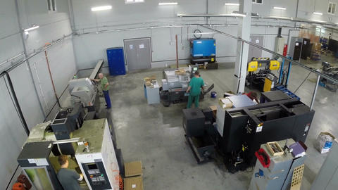Workers and automatic machines, aerial view Footage