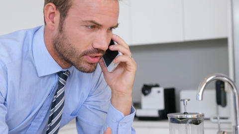 Businessman speaking at phone ビデオ