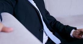 Smiling businessman using phone ビデオ