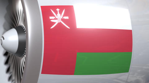 Airplane engine with flag of Oman. Omani air transportation conceptual 3D Live Action