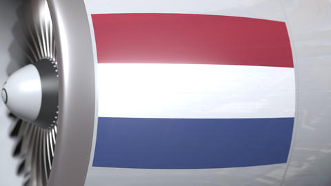 Airplane engine with flag of Netherlands. Dutch air transportation conceptual 3D Footage