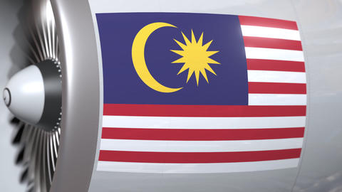Airplane turbine with flag of Malaysia. Malaysian transportation conceptual 3D Live Action