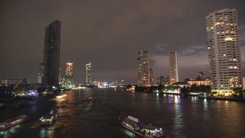 Time lapse, Cityscape view of Chao Phraya River at night Footage