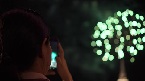Asian lady take a picture of fireworks with smartphone. Focus on lady. Specific on Songkran day Footage