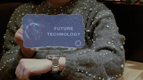 Woman uses hologram watch with text Future technology Footage