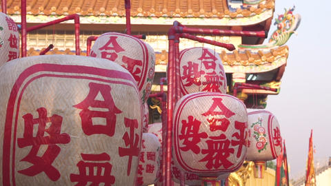 Lanterns with chinese character on it in front of chinese temple Live Action