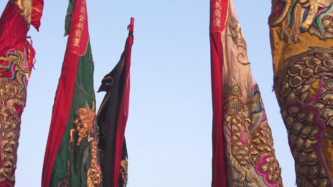 Chinese flags in chinese new year parade with dragon on it. Slow Motion Footage
