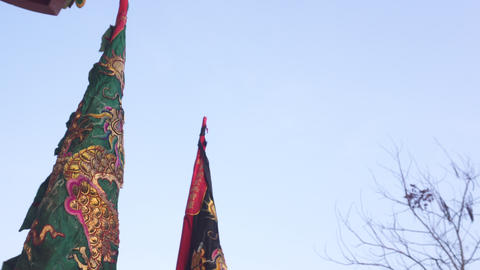 Chinese flags in chinese new year parade with dragon on it Footage