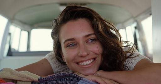 Young woman relaxing in camper van 4k Footage