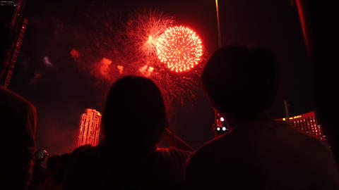 Unrecognized silhouette of love couple celebrating on big event. 4th july. new year. lunar new year. Footage