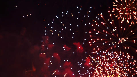 Fireworks exploding on celebration day, above the sky, in public place 3 Footage
