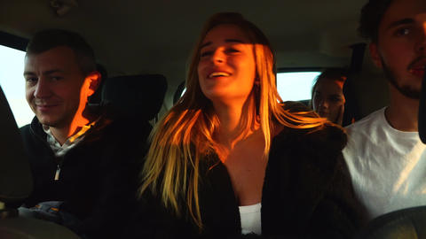 Funny friends talking on road trip driving big car to vacation. Cyprus Live Action