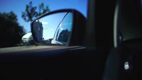 Reflection of street in the side mirror of a moving car by country road during Footage