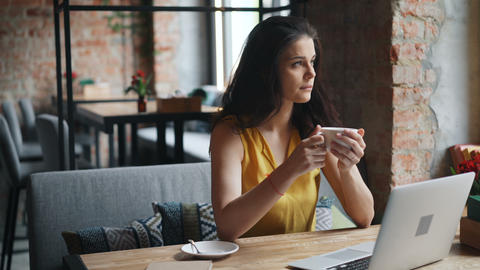 Beautiful young woman drinking coffee in cafe enjoying... Stock Video Footage