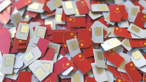 Pile of SIM cards with flag of China. Chinese mobile telecommunications related ビデオ
