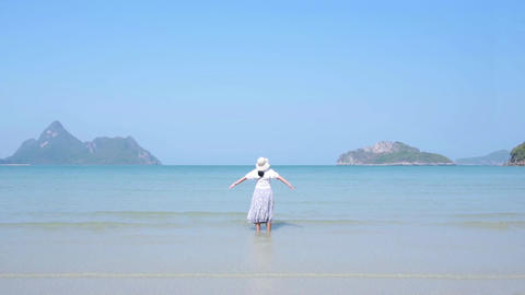 Asian lady get refreshing at beautiful beach. crystal blue sea. slow motion Live Action