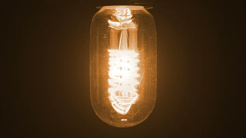 turn on and turn off in slow motion, retro vintage light bulb with old technology with filament Live Action