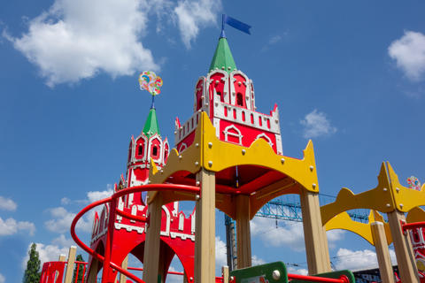Castle tower tops of kids playground on a cloudy blue sky background. Closeup of children outdoor Fotografía