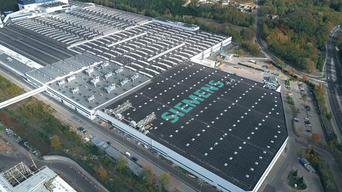 Logo of SIEMENS on the roof of an industrial facility, conceptual editorial clip Footage