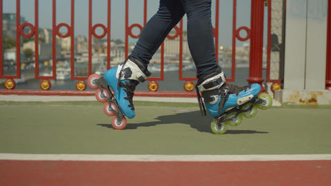 Skillful rollergirl's feet doing cross position Footage