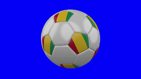 Soccer ball with Guinea flag on blue chroma key background, loop Animation